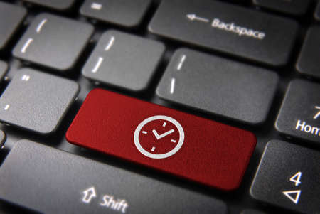 teleworker: Time key icon on laptop keyboard. Included clipping path, so you can easily edit it. Stock Photo