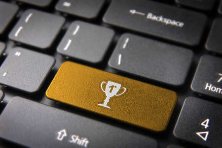 teleworker: Entertainment key with Trophy icon on laptop keyboard. Included clipping path, so you can easily edit it.