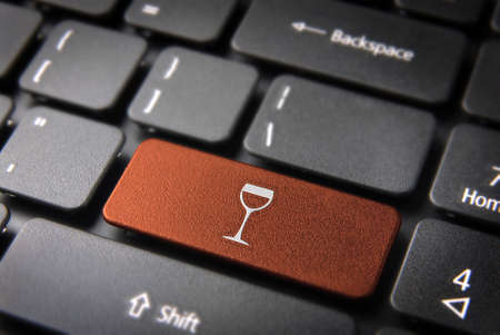 teleworker: Food key with Wineglass icon on laptop keyboard. Included clipping path, so you can easily edit it.