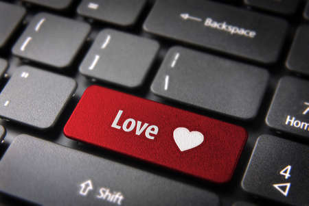 Valentines key with heart icon and love word on laptop keyboard. Included clipping path, so you can easily edit it. photo