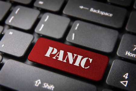 teleworker: Panic text in button key on laptop keyboard. Included clipping path, so you can easily edit it. Stock Photo