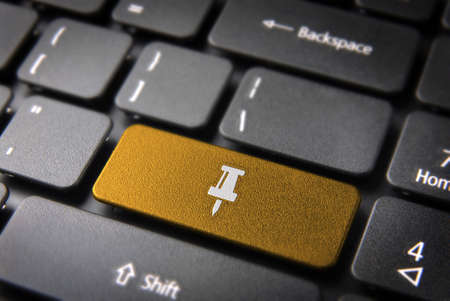 teleworker: Paper pin key icon on laptop keyboard. Included clipping path, so you can easily edit it. Stock Photo