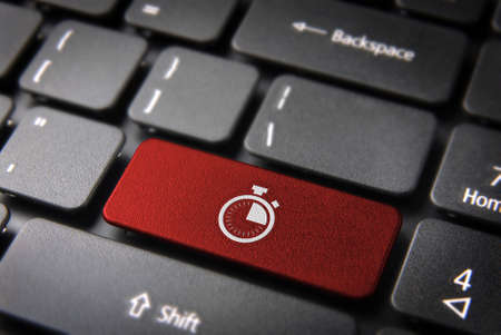 metering: Time key with stopwatch icon on laptop keyboard. Included clipping path, so you can easily edit it. Stock Photo