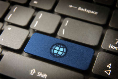 Internet key with Global icon on laptop keyboard. Included clipping path, so you can easily edit it. photo