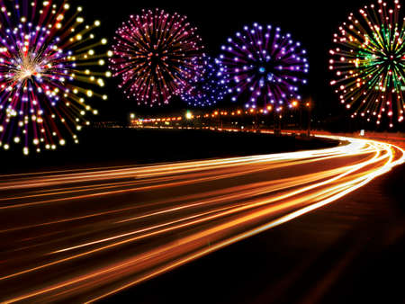 highway lights: Happy New Year fireworks and city cars highway lights with copy space for your own text.