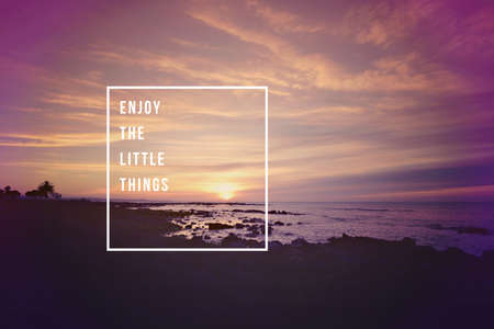 Enjoy the little things motivational inspiring quote concept with soft light sunset landscape background ideal for print card and poster design.