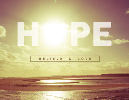 Hope believe and love motivational inspiring quote concept with vintage soft light sunset landscape background ideal for greeting card and poster design.