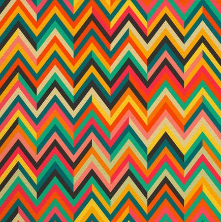 幾何学的な抽象的なカラフルなジグザグ ヴィンテージ レトロなシームレス パターン背景。理想的な生地は、包装紙や書籍カバー デザイン。EPS10 ベ