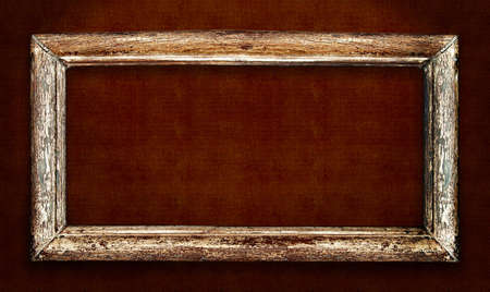 wall decor: Old wood picture frame over vintage fabric background. Includes clipping path, so you can easily cut and place on a design. Stock Photo