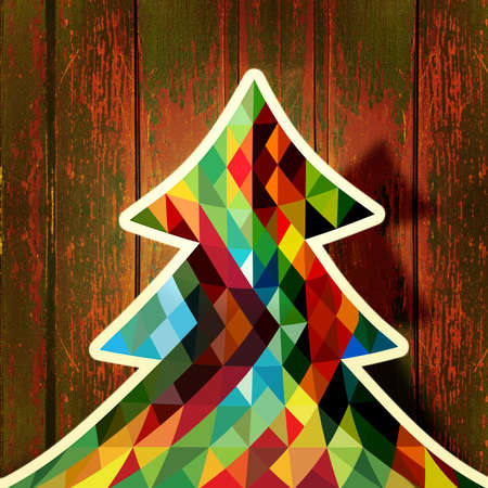 WOOD BACKGROUND: Trendy Christmas tree made with colorful triangles over vintage rust old wood background.