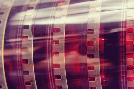 photography background: Closeup detail of vintage analog photography film strip background. Stock Photo