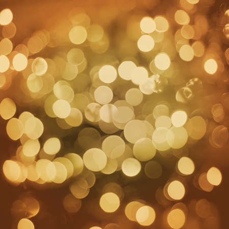 glam: Gold sparkle blur light elegant retro background. Ideal for holiday greeting card, event or party invitation.