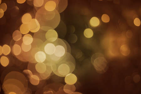 christmas light bulbs: Blur lights glitter background, bokeh effect in gold color. Ideal for celebration, holiday greeting card or event invitation. Stock Photo