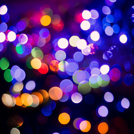 bokeh lights: Night celebration, colorful blur light abstract background. Ideal for holiday greeting card, party invitation or web backdrop. Stock Photo
