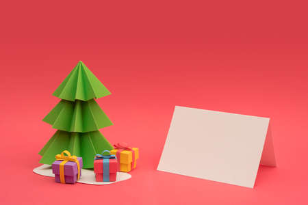 craft paper: Christmas season paper cut design: 3d handmade xmas pine tree, gift boxes and empty greeting card template with clipping path. Ideal for holiday project. Stock Photo
