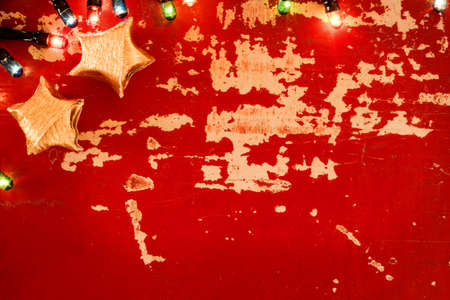 christmas gold: Holiday empty background concept template, vintage grunge wood texture with Christmas lights and decoration. Stock Photo