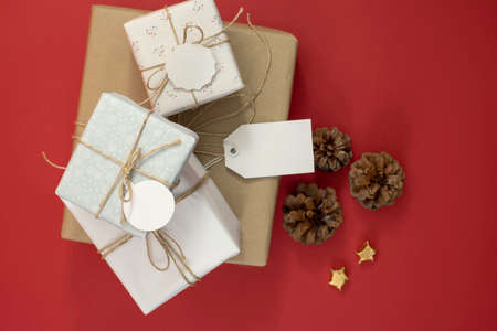 hang tag: Gift boxes pile for season time template top view with hipster rustic decoration, includes clipping path in empty labels and hang tag. Ideal for design your own business sale, Christmas or birthday.