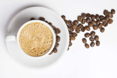 coffee beans: Delicious breakfast cup of coffee top view with foam and roasted bean decoration. Stock Photo