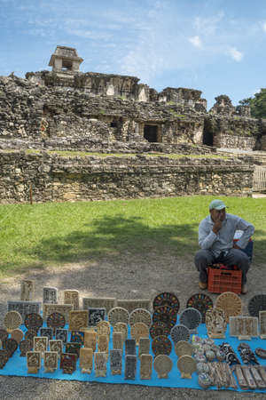 archaeological site: CHIAPAS, PALENQUE, MEXICO – MARCH 1, 2016: Craftsman sells decoration at archaeological site. Arts and crafts create diverse sources of income for mexican artisans living in rural areas.