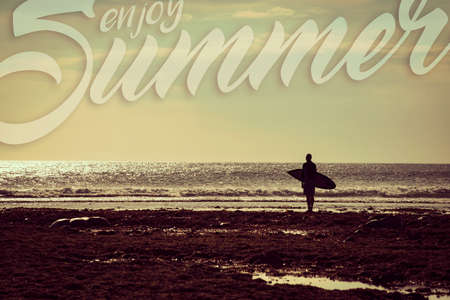 beach landscape: Surfer man silhouette in beach coast landscape with vintage filter. Enjoy summer vacation concept for surf greeting card or healthy lifestyle poster. Stock Photo