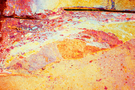 rust red: Abstract grunge texture background in red and yellow, creative paint stain backdrop with rust high contrast color.
