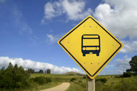 public transport: Public transport everywhere, more buses access concept. Road sign with bus stop icon in rural environment, includes copy space. Stock Photo