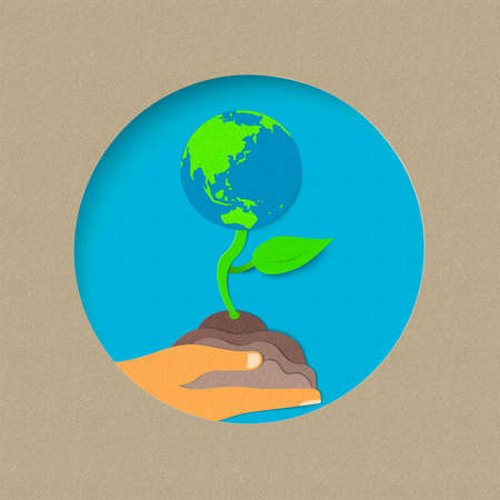 Earth day illustration for world environment care. Paper cut style plant growing from human hand. EPS10 vector.