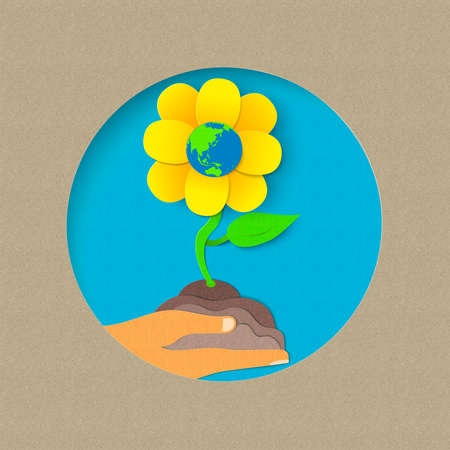 Earth day illustration for world environment care. Paper cut style flower growing from human hand. EPS10 vector.