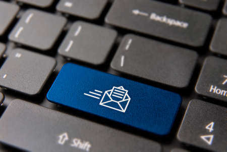 Web mail computer keyboard button for business mailing list or newsletter concept. New email icon key in blue color. 스톡 콘텐츠
