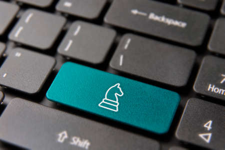 Business plan strategy computer button for intelligent market decision concept. Chess piece icon in blue color. Stock Photo