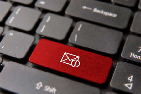 Web mail alert computer keyboard button for new email notification concept. Message envelope icon key in red color. Archivio Fotografico