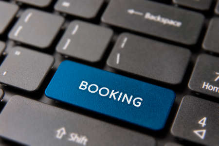 Business booking button for online holiday reservation concept. Book hotel icon in blue color.