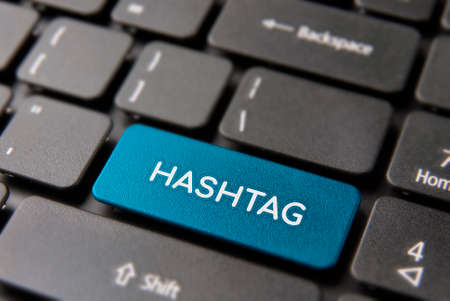 Social media hashtag button on computer keyboard for new popular trend concept. Hash tag text key in blue color.