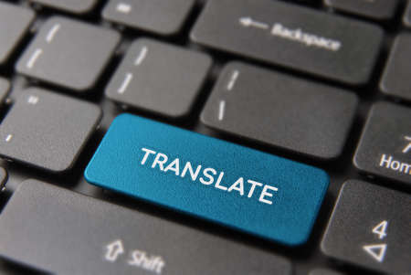 Multi language translation concept: blue computer button closeup with translate text on keyboard.  Banque d'images