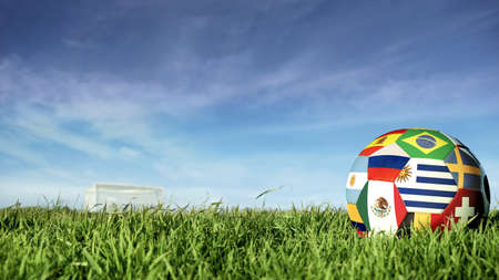 Soccer ball with international country flag of russian sport event groups. Realistic football on goal post field over blue sky background. Includes uruguay, russia, mexico and more. 写真素材