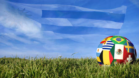 Soccer ball with Uruguay flag for Russian sport event, Uruguayan team celebration. Realistic football on grass field over blue sky background. Includes mexico, belgium and brazil flags. 写真素材