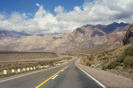 Mountain nature landscape with empty road. Tourism travel in Argentina, beautiful desert hill scenery of south america. Stock Photo