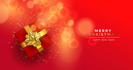 Merry Christmas Happy New Year greeting card, red holiday gift box with gold party confetti on blur light background.
