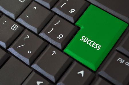 zwart toetsenbord met een sleutel tot succes Stockfoto