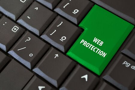 laptop keyboard with a black button access to the Internet with protection photo