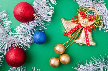 Christmas decoration objects on light green background photo