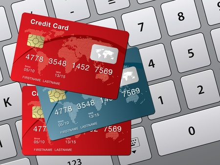 three credit card over the computer keyboard