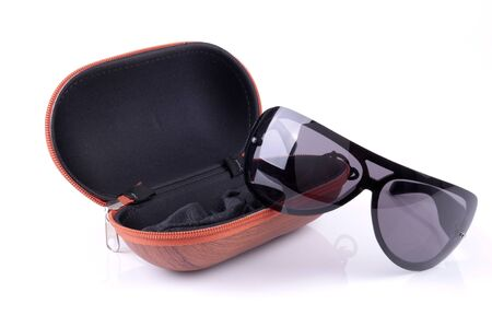 sunglasses and case on a white background photo