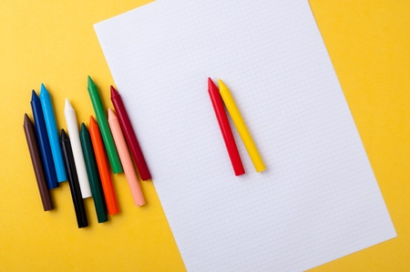 drawing paper and crayons colored yellow background Stock Photo - 10283874