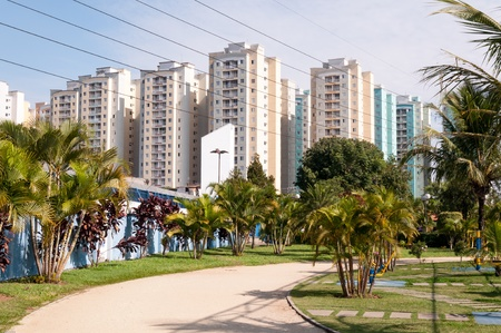 condominium complex: set of apartments near the park with jogging track Stock Photo