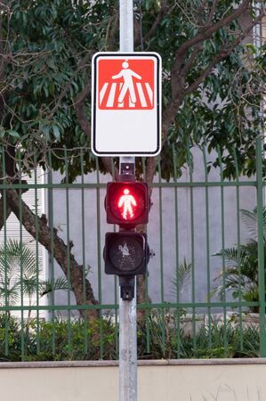traffic light for pedestrians indicating stop with the red light photo