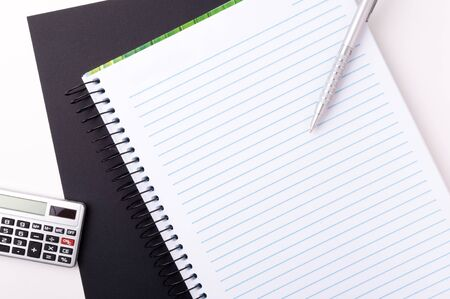 scratchpad: Blank spiral notebook with pen for notes