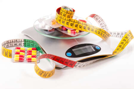 medicament: tape-measure and medicament about kitchen scale