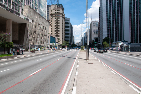 centers: SAO PAULO, BRAZIL - February 12  Paulista Avenue is one of the most important thoroughfares of the city of Sao Paulo, one of the main financial centers of the city on February 12, 2013, in Sao Paulo