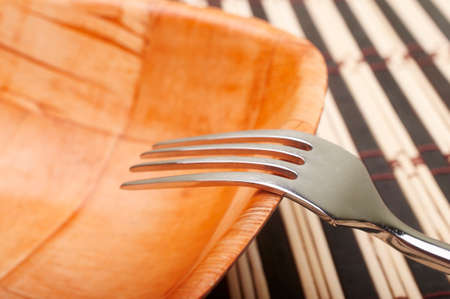 placemats: Fork closeup in bowl on placemats in dining table Stock Photo